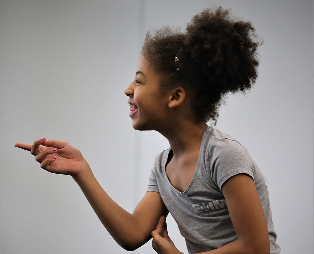 Girl pointing and laughing