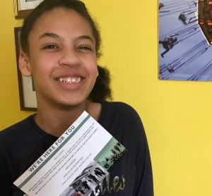 Young Participant holding postcard sent by Exim Dance during lockdown